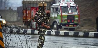 A CRPF soldier stands guard near the site of suicide bomb attack at Lathepora Awantipora in Pulwama | S Irfan | PTI File photo