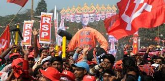 Left party activists carry an efigy of PM Modi as Ravana at Brigade ground in Kolkata | Ashok Nath Dey/ThePrint