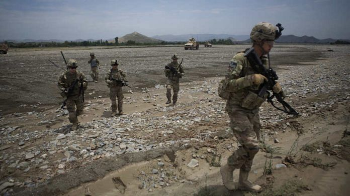 Soldiers from 2nd Platoon Fox Co. of the 2-506th Infantry Battalion of the 4th Brigade of the 101st Airborne Division conduct a counter indirect fire patrol from their base at COP Sabari in the Sabari district of Khost province, Afghanistan