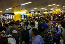 An immigration counter at the Indira Gandhi International Airport