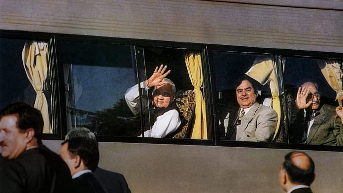In this Feb 19, 1999, file photo former prime minister Atal Bihari Vajpayee waves from the maiden Delhi-Lahore bus service on his arrival at Lahore to attend a Summit in Pakistan