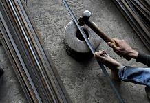 A worker hammers an iron rod at a workshop in Ahmedabad (representational image) | Anindito Mukherjee/Bloomberg