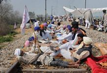 Farmers block railway tracks during a protest organised under the banner of Kisan Mazdoor Sangharsh Committee (KMSC) against the alleged anti-farmer policies of Punjab government