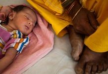 A child sleeps by its mother at the post delivery ward in a health center in Jindh |Prashanth Vishwanathan/Bloomberg