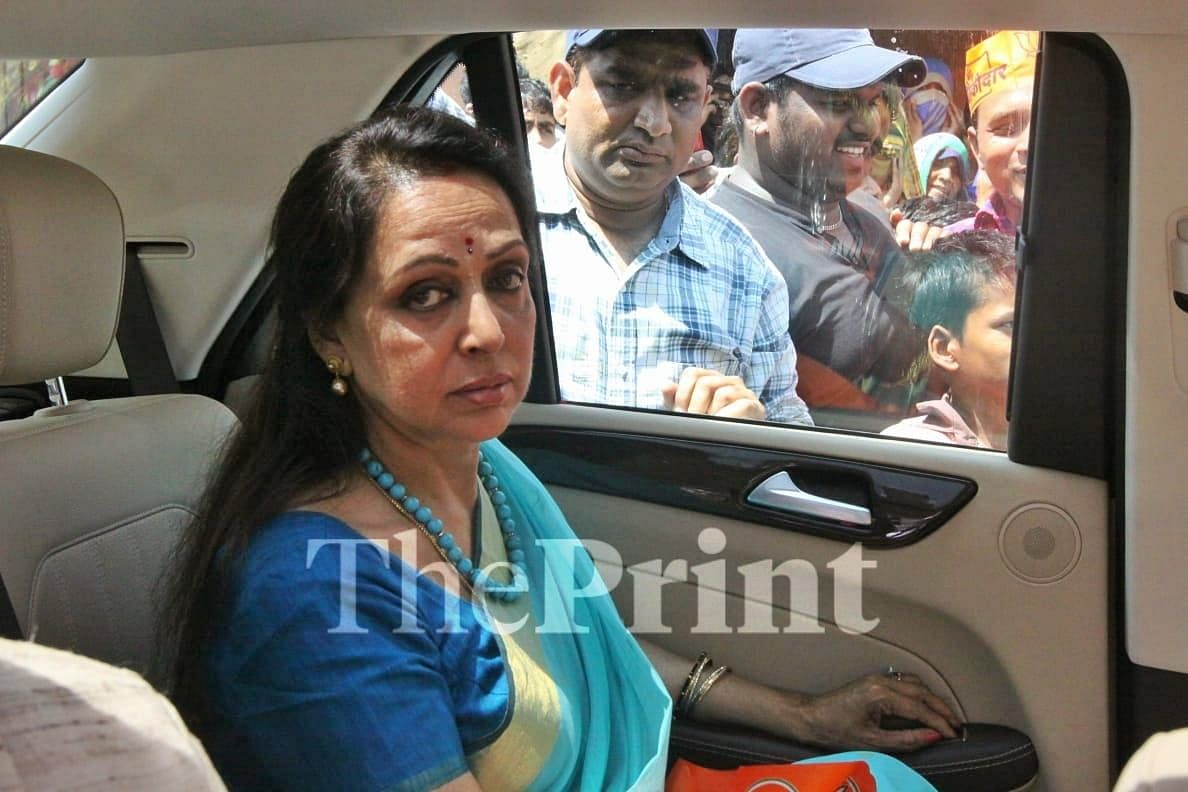 Hema Malini wrinkles up her nose when someone stands between her vehicle and the one in front which holds the public address system  Praveen Jain/ ThePrint
