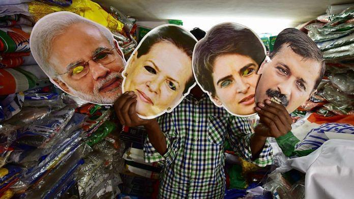 A salesman displays masks of PM Modi, Congress leaders Sonia Gandhi, Priyanka Gandhi and AAP leader Arvind Kejriwal at a shop, ahead of the Lok Sabha polls | PTI