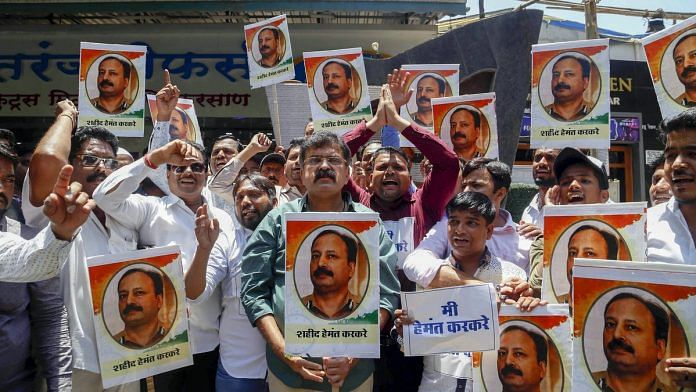 NCP workers protest Pragya Singh Thakur's comment against Hemant Karkare, in Thane | PTI