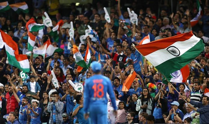Captain Virat Kohli looks towards a sea of supporters