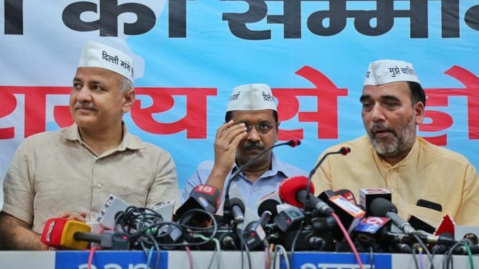 Manish Sisodia, Arvind Kejriwal and Gopal Rai at the launch of AAP manifesto