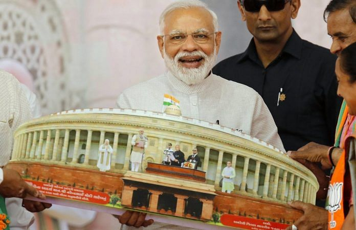 File photo of PM Narendra Modi being presented a memento during an election campaign, Gujarat | PTI