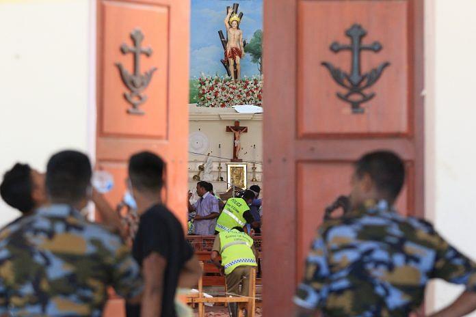 Sri Lankan soldiers inspect the damage inside St. Sebastian's Church where a bomb blast took place in Negombo, Sri Lanka. | Tharaka Basnayaka | Bloomberg