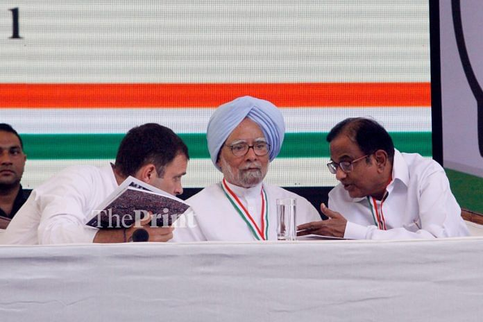 Congress president Rahul Gandhi (L) shares a word with former PM Manmohan Singh (M) as former finance minister P. Chidambaram listens | Praveen Jain/ThePrint