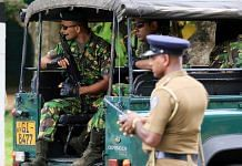 Special Task Force (STF) police officers sit in a vehicle arriving at the Parliament of Sri Lanka in Colombo