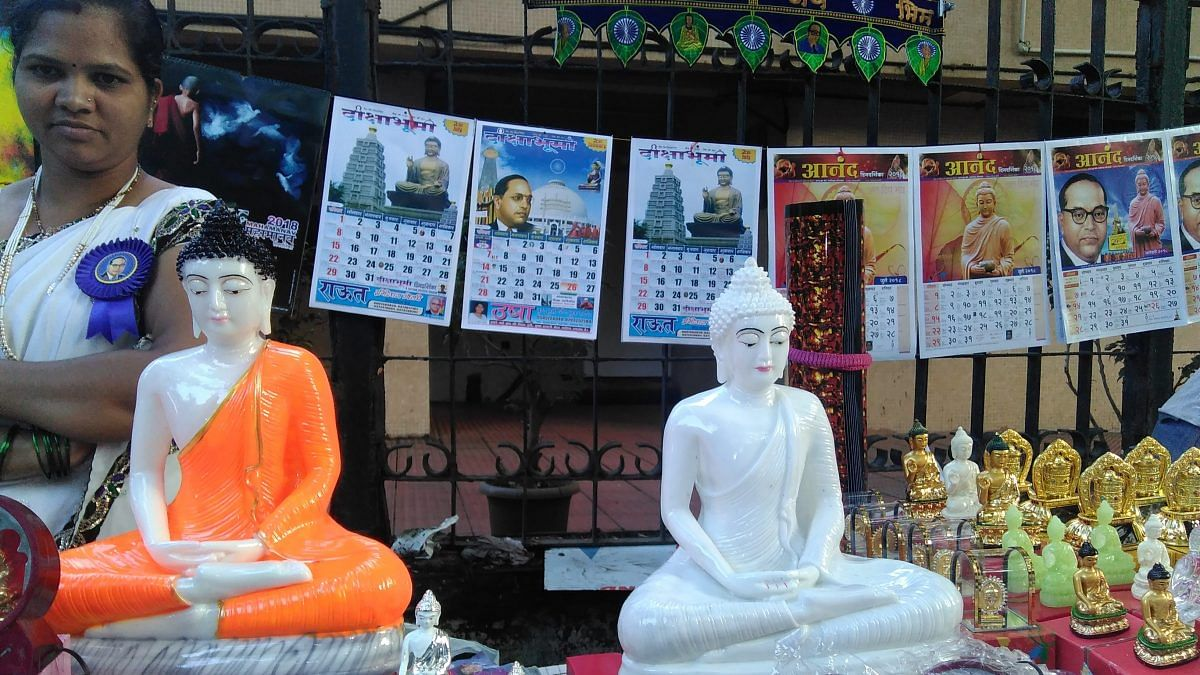 Calendars and statues of the Buddha and BR Ambedkar at a shop | Commons