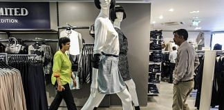 Customers browse cloths inside a store in Mumbai | Dhiraj Singh/Bloomberg