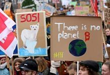High school students demonstrate against global warming.   Adam Berry / Getty Images