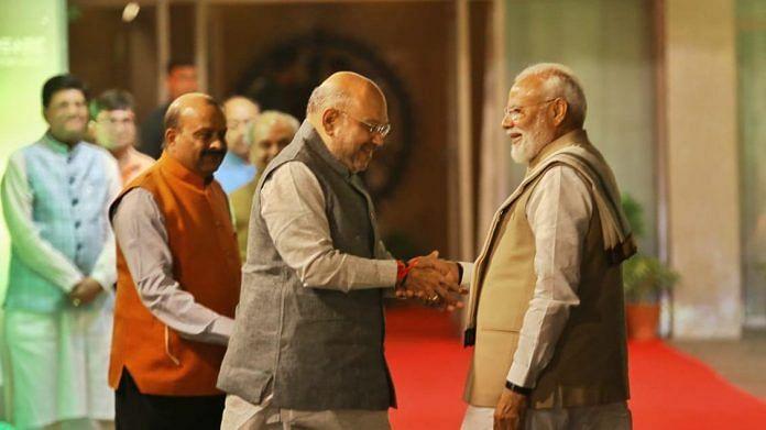 File photo | Prime Minister Narendra Modi shakes hands with BJP president Amit Shah in New Delhi. | Suraj Singh Bisht | ThePrint
