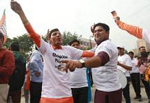 BJP workers celebrate at the party's headquarters in New Delhi | Manisha Mondal | ThePrint