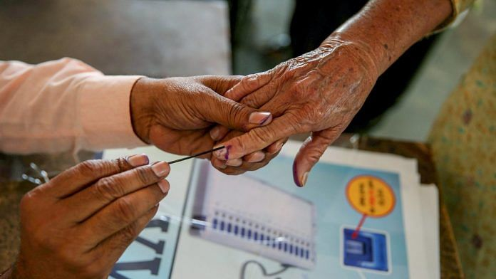File photo: A voter at a polling booth in village Bhoot, near Amritsar | PTI