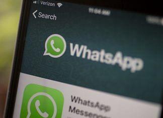 WhatsApp app logo displayed on a phone