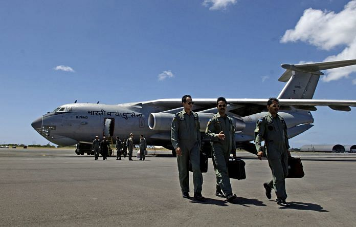 Indian air force pilots walk away from their IL-76 medium cargo jet after landing