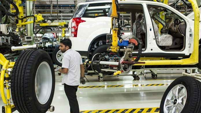 An employee fits a wheel in a car factory | Representational image | Photo: Udit Kulshrestha/Bloomberg