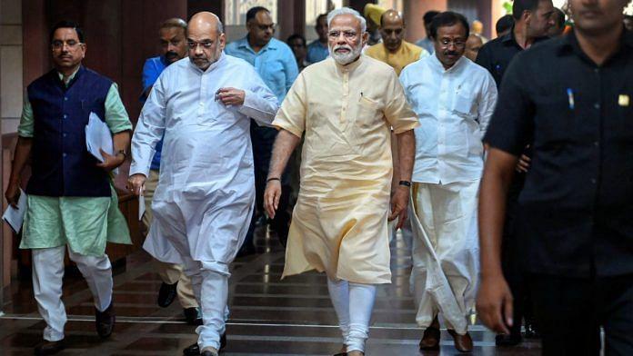 Prime Minister Narendra Modi, Union Home Minister and BJP President Amit Shah at Parliament library, New Delhi | File photo: PTI