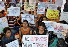 Junior doctors hold placards during their strike in protest against an attack on an intern doctor in Kolkata. | File photo: PTI