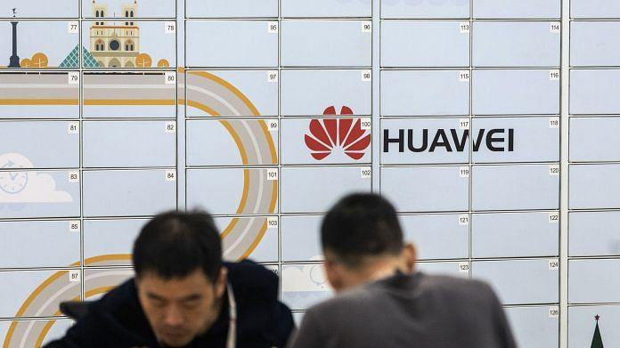 The Huawei Technologies Co. logo | Bloomberg