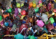 People rush to fill their vessels from a water tanker in Chennai | File photo: PTI