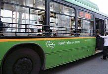 A man boarding a DTC bus | Photo: Manisha Mondal | ThePrint
