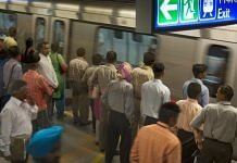 Commuters wait for a train at Rajiv Chowk Metro station