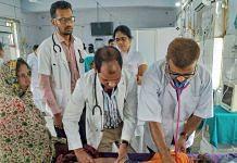A doctor treats a child showing symptoms of Acute Encephalitis Syndrome at a hospital in Muzaffarpur | Photo: PTI