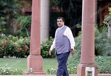 Nitin Gadkari walks towards his car