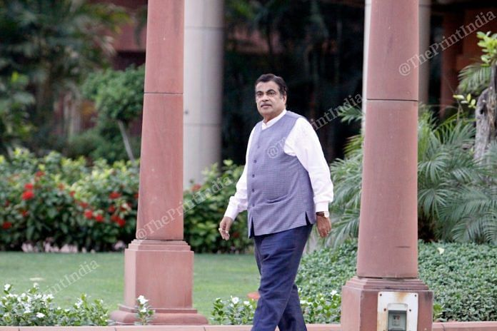 Nitin Gadkari walks towards his car