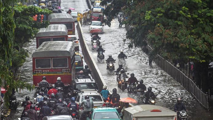 Vehicles move through waterlogged streets during heavy monsoon rain, in Mumbai, on 1 July, 2019 | Photo: Mitesh Bhuvad | PTI