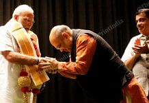 Home Minister Amit Shah greets PM Narendra Modi at BJP Parliamentary Party meeting