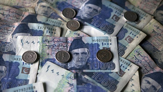 Pakistani one thousand rupee banknotes and coins in Pakistan. | Photographer: Asim Hafeez | Bloomberg