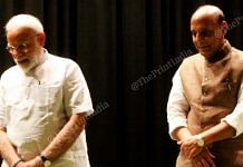 PM Narendra Modi stands with Defence Minister Rajnath Singh