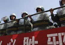 Paramilitary police in Urumqi, Xinjiang province, China | Photo: Nelson Ching/Bloomberg News