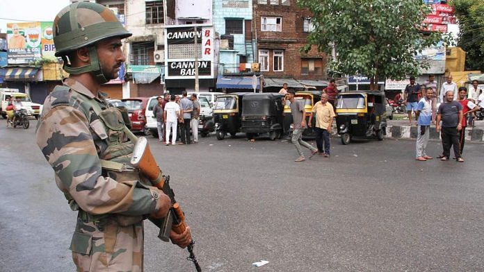 Army personnel stand guard during restrictions in Jammu, on 5 August, 2019 | PTI