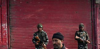 Members of the security forces stand guard in front of a shuttered store in Srinagar, Jammu and Kashmir| File photo | Anindito Mukherjee/Bloomberg