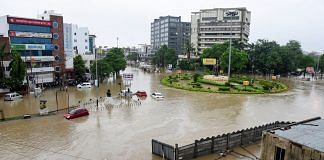 A view of flooded streets in the city following incessant monsoon rainfall, in Vadodara, | PTI