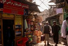 Pedestrians walk through an alley at the Kah Froshi bird market in Kabul, Afghanistan | Photographer: Jim Huylebroek | Bloomberg
