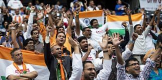 File photo | Attendees cheer as PM Narendra Modi (not pictured) speaks during the Howdy Modi Community Summit in Houston, Texas| Photo: Scott Dalton | Bloomberg