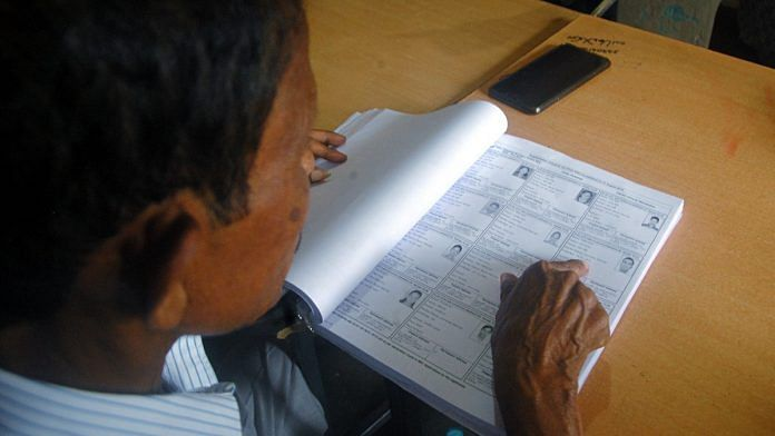 File photo   A man checks his name in NRC list in Guwahati on 31 August 2019   ANI Photo