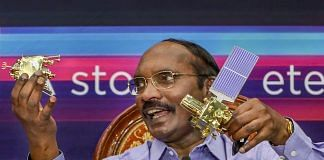 ISRO Chairman K Sivan displays a model of Chanrayaan 2 orbiter and rover during a press conference in Bengaluru on 20 August. | PTI