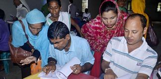 People check their names on the NRC final list at a NRC centre in Buraburi Gaon, Morigaon.