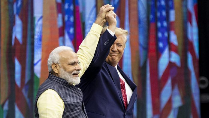 PM Narendra Modi and US President Donald Trump raise hands on stage during the Howdy Modi event in Houston, Texas | Scott Dalton/Bloomberg