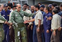 Defence Minister Rajnath Singh meets HAL employees after a sortie in LCA Tejas in Bengaluru on 19 September | PTI
